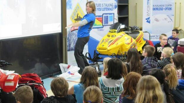 Lori Zacaruk runs an avalanche training company specifically for snowmobilers.