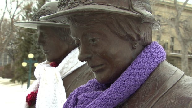 Statues depicting The Famous Fives are adorned in knitted scarves after a group of Winnipeggers knit them to honour some women getting the right to vote in Manitoba on the movement's 100th anniversary.