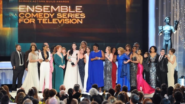 Cast and crew of Orange Is the New Black accept the award for outstanding ensemble in a comedy series at the 22nd annual Screen Actors Guild Awards on Jan. 30.