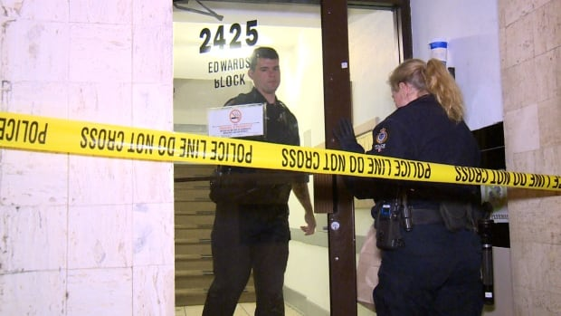 A Vancouver police forensics investigator enters a building on Granville Street, after a man was found dead in an apartment Saturday night.