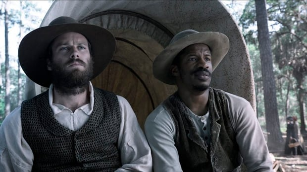 This image provided by the Sundance Institute shows Armie Hammer, left, and Nate Parker in a scene from the film The Birth of a Nation, directed by Nate Parker. The movie won two top awards at the Sundance Film Festival.