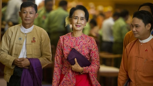 Myanmar's National League for Democracy (NLD) chairperson Aung San Suu Kyi leaves after the new lower house parliamentary session in Naypyidaw, Burma on Monday.