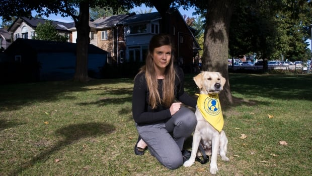 Kalyna Kardash is shown with Kora, a British golden retriever in training to become a service dog to assist wounded soldiers in the conflict in eastern Ukraine. Kardash spearheaded a mental-health rehabilitation project called Hero's Companion.