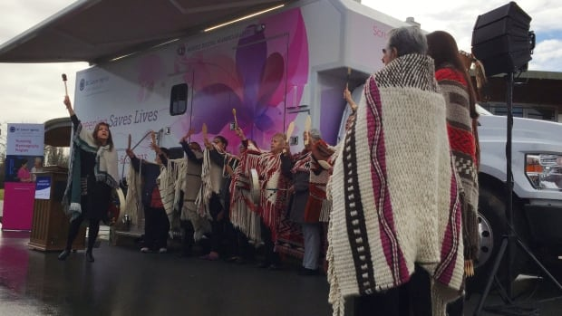 The Musqueam First Nation blessed the BC Cancer Agency's two new digital mobile coaches at a ceremony on Monday.