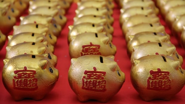 Golden piggy banks are displayed in Binzhou, China. The Lunar New Year is a time to look forward with hope for prosperity.