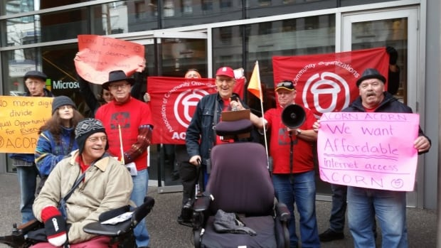 ACORN members rally for lower prices for high-speed home internet outside the CRTC offices in Vancouver