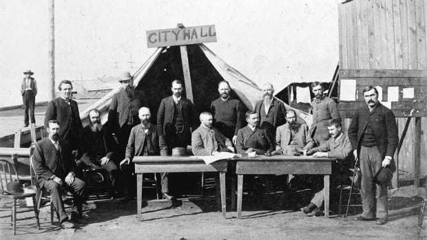 Vancouver City Council meets in a tent after the Great Fire of 1886. Council minutes from this period are being digitized in the Transcribimus project.