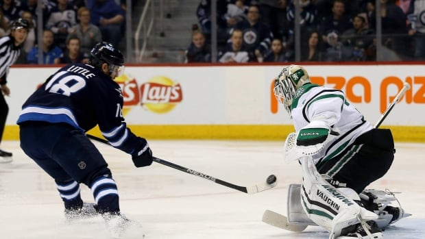 Winnipeg Jets' Bryan Little (18) misses on a breakaway opportunity in front of Dallas Stars goaltender Antti Niemi (31) during second period NHL hockey action in Winnipeg, Tuesday, February 2, 2016.
