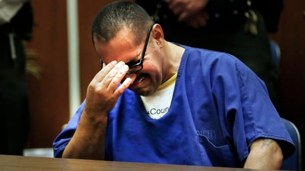Luis Vargas reacts in court as he is exonerated on Nov. 23, 2015  in Los Angeles. A judge exonerated Vargas, convicted of three rapes, after DNA evidence linked the crimes to a serial rapist wanted for assaults dating back two decades.