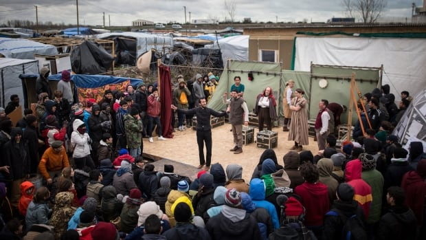 Actors from Shakespeare's Globe Theatre perform Hamlet for migrants at the Good Chance Theatre Tent in France's Jungle refugee camp in Calais on Wednesday.