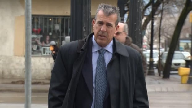 Det. Sgt. Greg Jackson is seen here entering the John Sopinka Courthouse in Hamilton on Wednesday. Jackson testified about the police investigation that led to the arrest of Dellen Millard, who is accused of first-degree murder in the case.