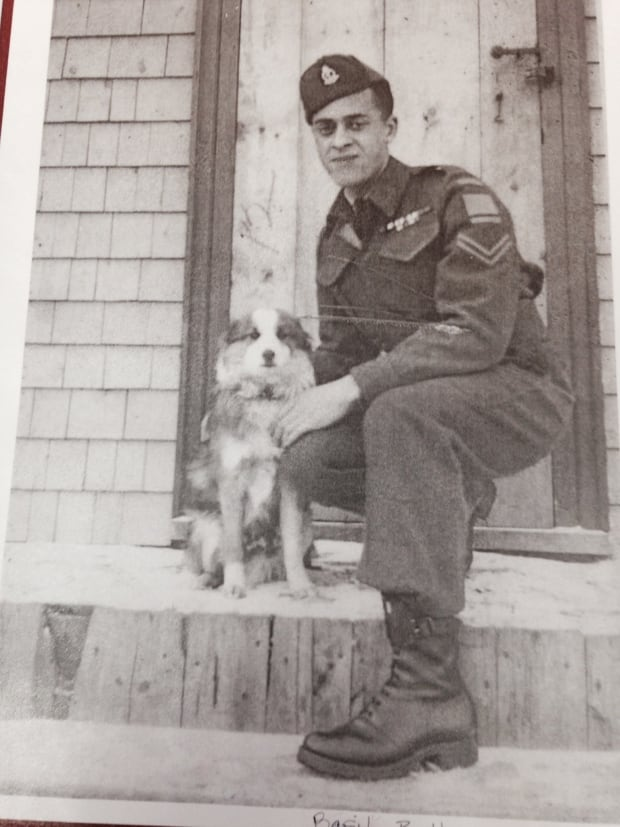 Private Basil Bell and a furry friend pose for a photo.