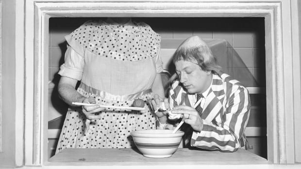 In this Jan. 2, 1952, file photo, Ray Goulding, left, playing the character Mary McGoon, instructs Bob Elliott, playing the character Uncle Eugene, right, on meatball stuffing.