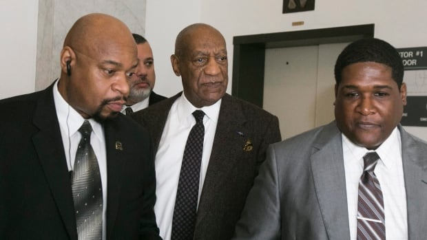 Bill Cosby, centre, leaves after a court appearance in Norristown, Pa. earlier in February. Judge Steven O'Neill has denied the actor and comedian's latest bid to end the the sexual assault case against him.