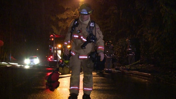 A North Vancouver District firefighter leaves the scene of a small fire early Thursday morning on Forest Hill Drive.