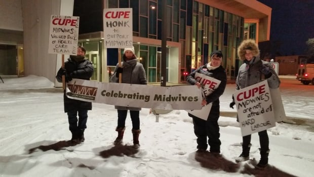 Dozens gathered outside Winnipeg's Birth Centre in February to hold an informational picket, calling for better compensation for midwives in the province.