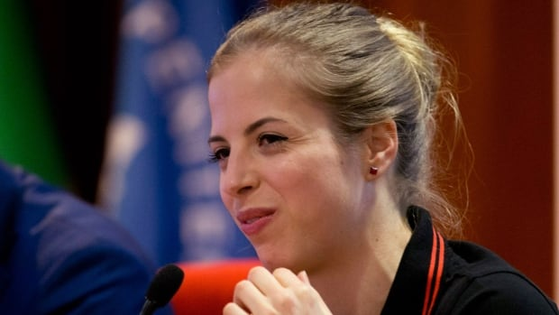 Italian figure skater Carolina Kostner smiles during a press conference in Rome Thursday. The former world champion announced she will return to competition in September after completing a suspension for helping her ex-boyfriend evade doping controls.