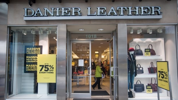 A shopper is seen inside a Danier Leather store in downtown Vancouver, on Feb. 4, 2016. Danier Leather Inc. said it has entered insolvency proceedings in order to protect itself from creditor lawsuits as it seeks a buyer.