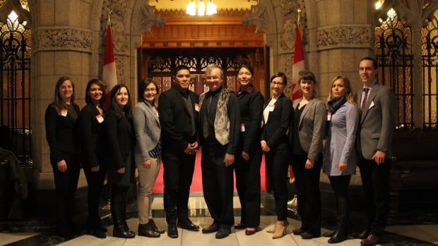 The Jane Glassco Fellows pose with Nunavut Senator Dennis Patterson, after being officially recognized in the Senate chambers.