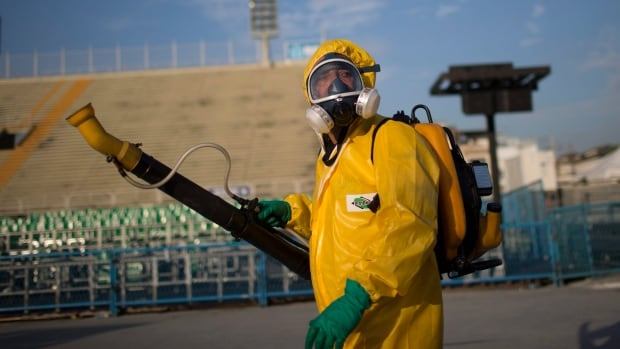 A health worker sprays insecticide to combat the Aedes aegypti mosquitoes that transmit the Zika virus at the Sambadrome, an Olympic venue, in Rio de Janeiro.