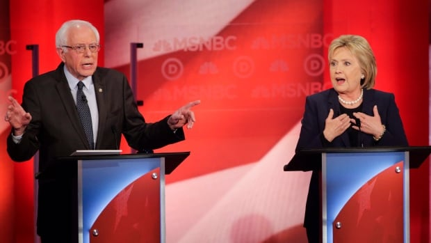 Democratic presidential candidate, Sen. Bernie Sanders, I-Vt,  and Democratic presidential candidate, former Secretary of State Hillary Clinton spar during a primary debate hosted by MSNBC at the University of New Hampshire Thursday.