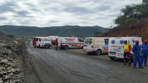 Ambulances are seen at a South African gold mine in the eastern town of Barberton after a building collapsed Friday, trapping about 87 people. After several hours, most of them were rescued, but three people remained missing
