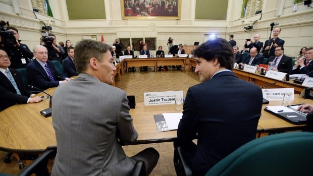 "Prime Minister Justin Trudeau talks with Vancouver Mayor Gregor Robertson (left) as he sits down with Canada's big city mayors Friday morning on Parliament Hill. Robertson praised Trudeau's ""positive approach"" toward cities and infrastructure issues."
