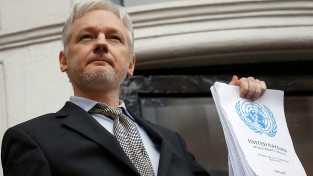 WikiLeaks founder Julian Assange holds a UN report that argues he has been 'arbitrarily detained' by Britain and Sweden since December 2010. Assange spoke with Carol Off on CBC Radio's As it Happens this week.