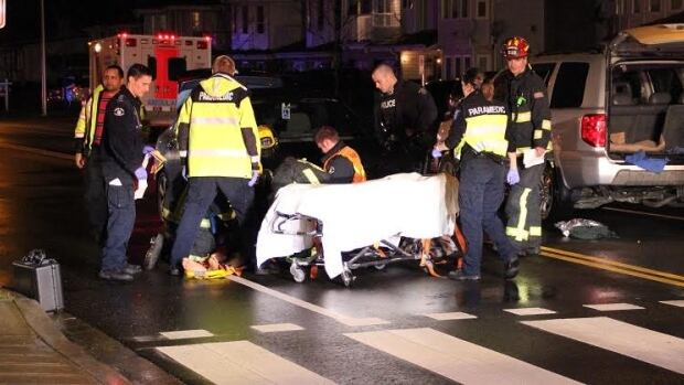 One of the two men struck last night in a Surrey crosswalk was thrown under a second car travelling in the opposite direction.