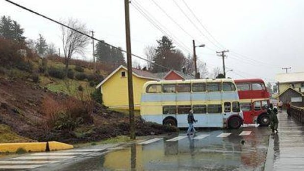 A small landslide near Port McNeill has pushes three buses into the road near the Alert Bay ferry terminal.