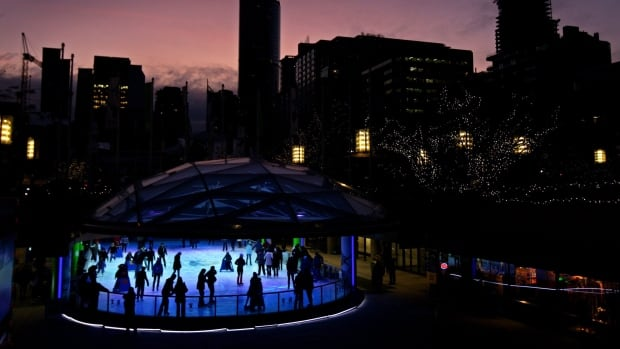 People skate on the downtown outdoor skating rink at Robson Square at dusk in Vancouver, B.C., on Thursday December 10, 2009.