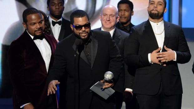 F. Gary Gray, left, Ice Cube, center, O'Shea Jackson Jr., right, and the cast of Straight Outta Compton accept award for Outstanding Motion Picture at the 47th NAACP Image Awards Friday.