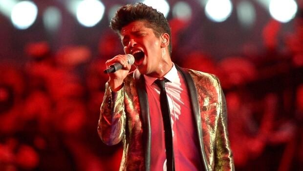 FILE - Bruno Mars, seen here during the well-received halftime show in February 2014, confirmed on Instagram he will make an appearance at this year's performance.