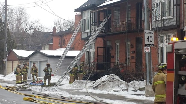 Firefighters battle a fire that broke out in the basement of a home on Strathcona Avenue.