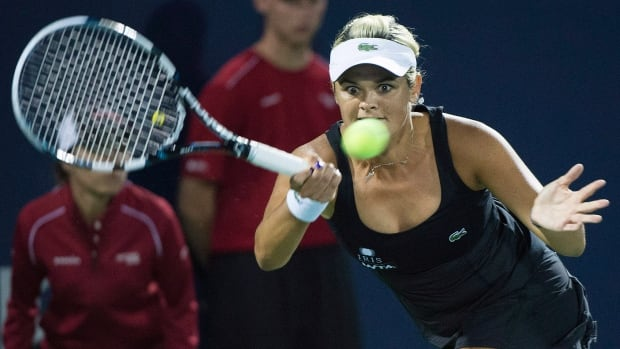 Canada's Aleksandra Wozniak helped her country pull even with Belarus with her 40th Fed Cup win.