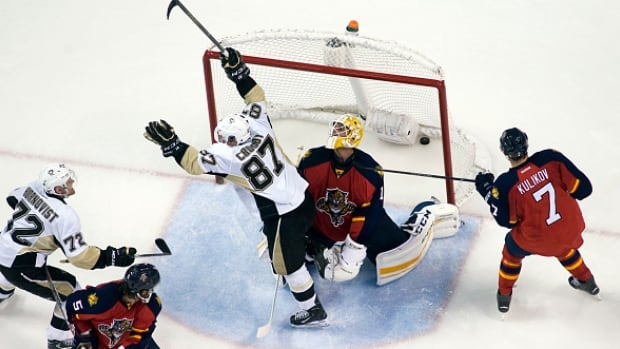 Pittsburgh Penguins centre Sidney Crosby scored the game-tying goal on Saturday night to rally his team to a 3-2 victory over the Florida Panthers and welcome a big career milestone.