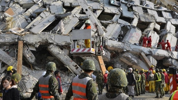 Rescue workers continued the search for survivors at the Wei-kuan apartment complex on the second day of rescue operations following a 6.4 magnitude earthquake early Saturday in southern Taiwan's city of Tainan.
