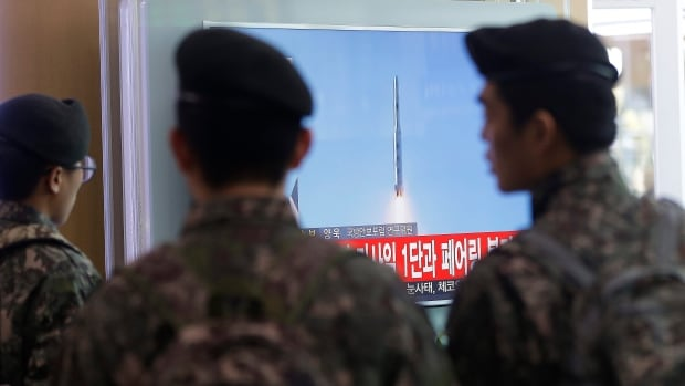 South Korean army soldiers watch a TV news program about North Korea's rocket launch at Seoul Railway Station in Seoul, South Korea, Sunday, Feb. 7, 2016.