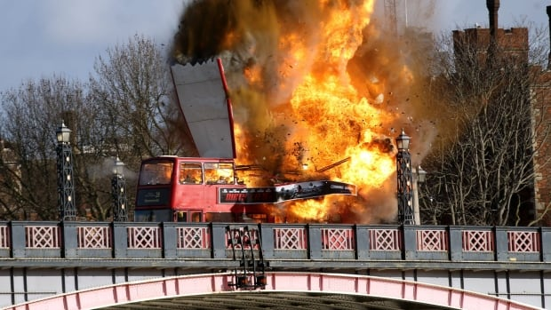 A bus explodes on Lambeth Bridge, during filming for Jackie Chan's new film The Foreigner in London on Sunday. It sparked concerns from the public that it might be real.