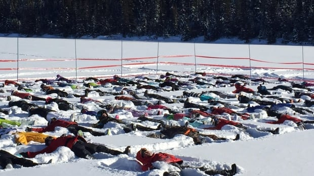 More than 100 people showed up to the ski hill in Labrador City Saturday to beat the world record for most snow angels made simultaneously.