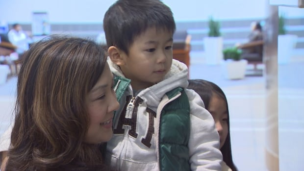 "Michelle Siu with her son Cameron, who was diagnosed with autism when he was three years old. ""It was overwhelming,"" said Siu about coping with the disorder at first."