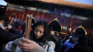 LUNAR-NEW YEAR prayers at Yonghegong Lama Temple in Beijing Feb 8