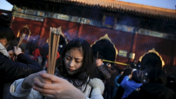 Thousands of people gathered to burn incense and pray for good fortune at Yonghegong Lama Temple in Beijing in observance of the first day of the Lunar New Year on Feb. 8, 2016.