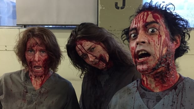 Dozens of movie extras are playing zombies in a still-to-be-announced production filming inside Vancouver's old post office this month.