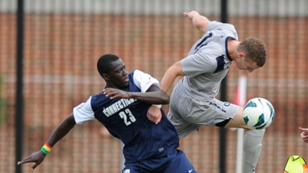 Cole Seiler, right, attempts to keep the ball in play against Connecticut forward Mamadou Diouf (23). The Vancouver Whitecaps signed the 22-year-old first round pick Monday.