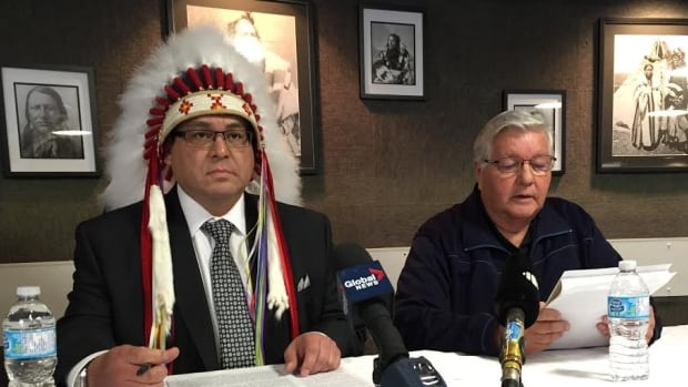 Jim Brule, Poundmaker's Lodge chairman and executive director Brad Cardinal speak with reporters Monday.