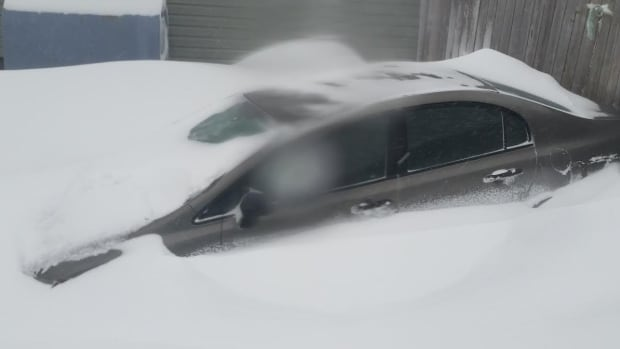 This buried car was typical of many during Tuesday's blizzard.