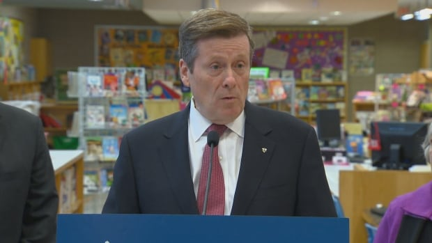 Mayor John Tory speaks to reporters after helping out at a breakfast program at Thorncliffe Park Public School on Tuesday.