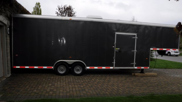 Police officers testified that the trailer was found jammed right up against the garage door of the home in Kleinburg, Ont.