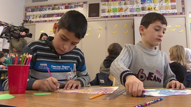Students Mohamed and Abdel Baree are adapting to life at Regina schools after arriving from Syria about a week ago.